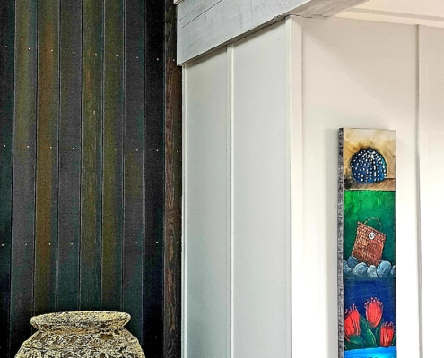 Contrasting timbers and stains in interior of bach by Whelan Building on Waiheke Island