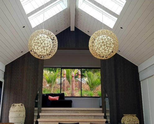Contrasting timber and stains interior of bach on Waiheke Island